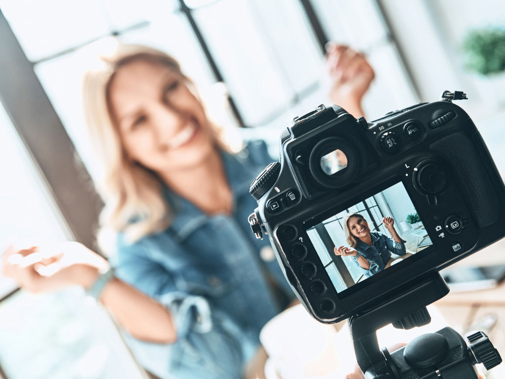 Image of influencer in front of a camera