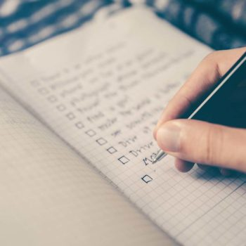 Pen writing on checklist
